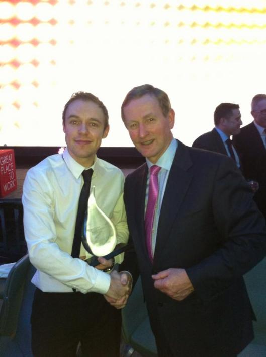 Cian Corbett and An Taoiseach Enda Kenny at the Great Place to Work Awards 2014